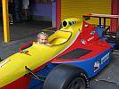 Em drives Formula 1.