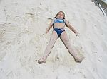 Emily makes a sand angel.